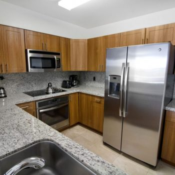 Kitchen of an Apartment at Seacoast Suites
